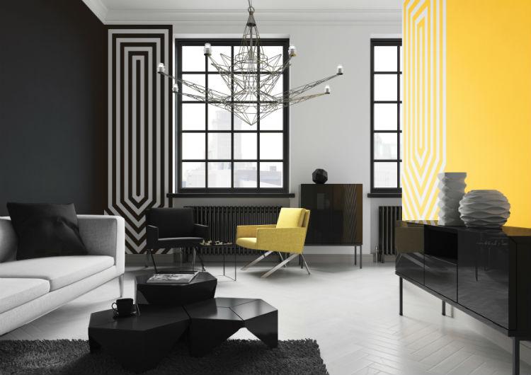Geometria koloru Osoby stroniące od motywów roślinnych mogą pokusić się o wprowadzenie soczystych kolorów do mieszkania, decydując się na rozwiązania z trendu Geometria koloru. Do barw podstawowych –czerwonej, żółtej czy niebieskiej, dobierzmy biel i czerń. Inspiracje można czerpać z dziedzictwa modernizmu i sztuki pop-artu. Na ścianach dobrze będą wyglądać obrazy w formie plakatów bądź ręcznie malowane napisy. W takie otoczenie wyśmienicie wtopią się meble wykonane z ciemnych, metalowych prętów. Misz-masz jest w tym stylu jest wręcz wskazany. Trendy kolorystyczne Śnieżka 2015 - Geometria koloru